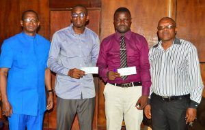 Prof. Madu, Ag. Director of CBSS Dr. Okere with Ossai and  the Award Winners